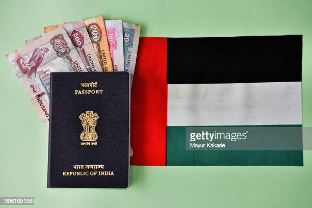 indian passport with uae currency notes and flag - gulf countries stock pictures, royalty-free photos & images