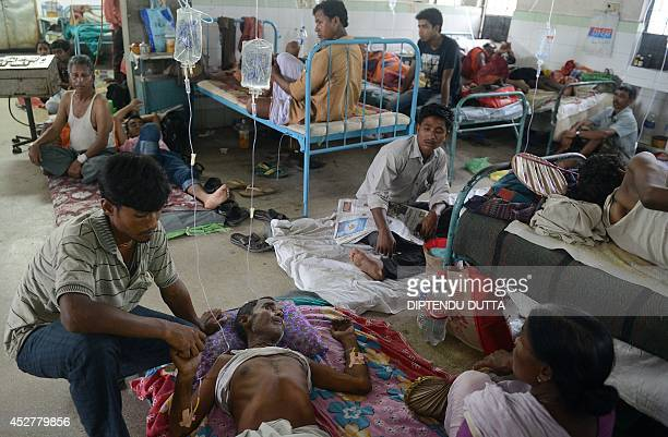 Indian patients receive treatment for encephalitis at the North Bengal Medical College Hospital on the outskirts of Siliguri on July 27 2014...