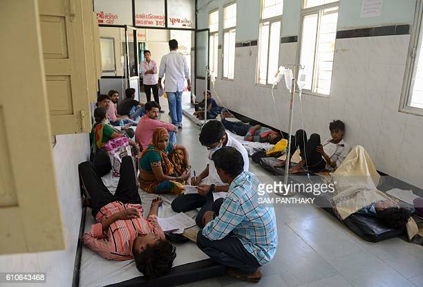 Indian patients undertaking treatment for viral infections including dengue fever are seen at Vadilal Sarabhai hospital in Ahmedabad on September 27...