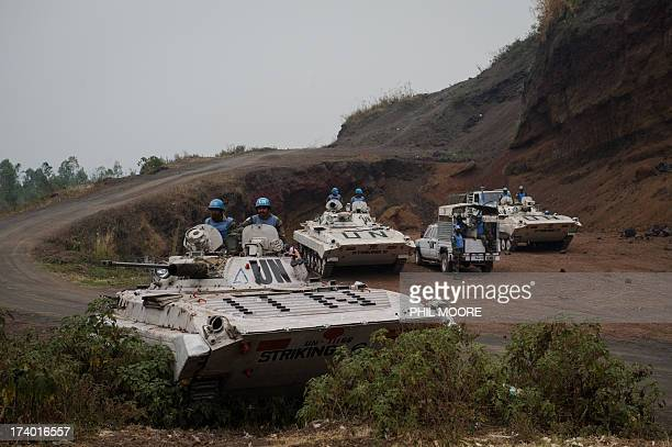 Indian peacekeepers operating as part of the United Nations Stabilisation Mission for the Congo wait at the foremost position behind Congolese army...