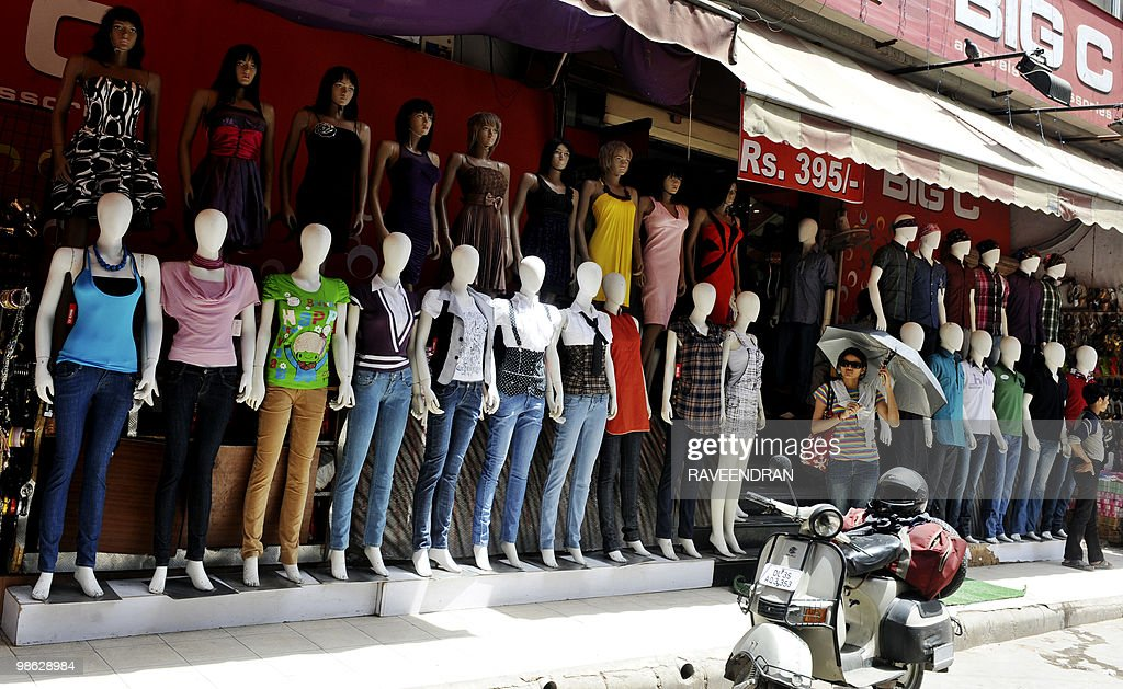 Indian pedestrians walk past mannequins at a ready made cloth market in New Delhi on April 23, 2010. The number of Indians living in cities will nearly double to about 600 million by 2030, requiring huge investment to avoid urban 'chaos', a report by global consultancy McKinsey warned. India must invest 1.2 trillion dollars on core urban infrastructure in its cities over the next 20 years, equivalent to 134 dollars per capita a year, the report said -- almost eight times current spending in per capita terms.