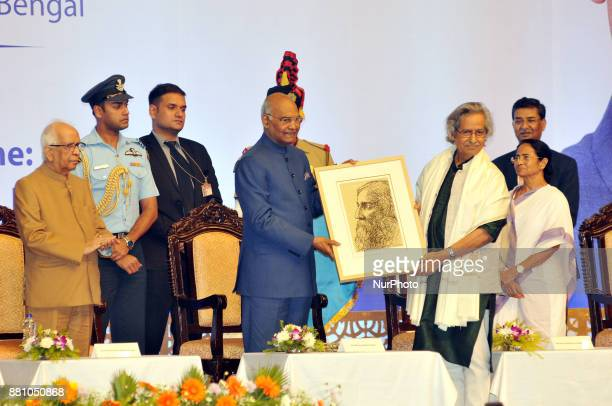 Indian Penter Jogen Chowdhury present to his penting to Ramnath Kovind President of India during West Bengal Government Felicitate to President of...