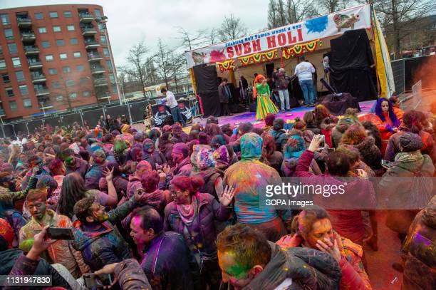 Indian people are seen dancing and having fun during the celebration Millions of people around the world celebrate the annual Holi Hangámá Festival...