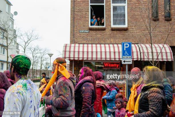 Indian people are seen walking around the district during the celebration Millions of people around the world celebrate the annual Holi Hangámá...