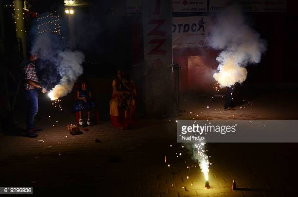 Indian people burst fire crackers as smokes of fire crackers appears in atmosphere on the ocassion of Diwali festival in Allahabad on October...