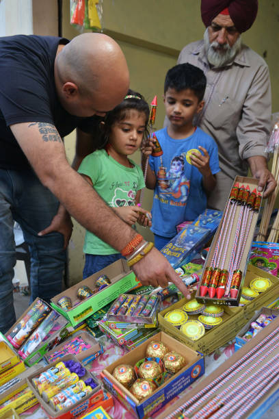 Indian people buy firecrackers ahead of celebrations of Diwali festival in Amritsar on October 17 2017 Festival of light Diwali is one of the most...