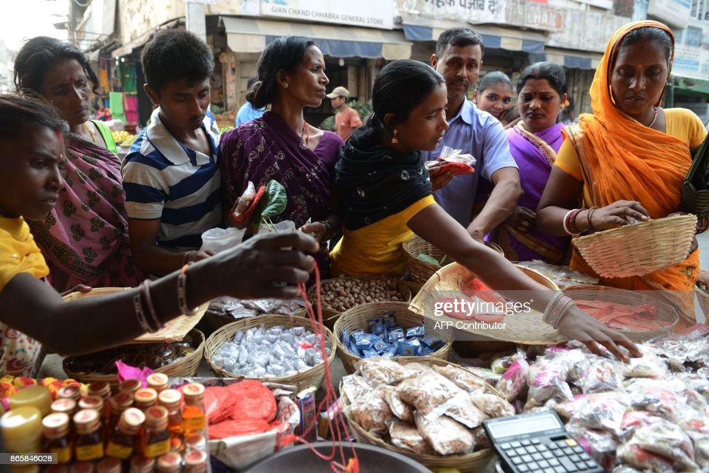 Indian people buy religious items to perform prayers ahead