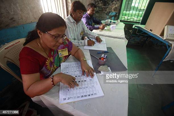 Indian people cast their vote during the Maharashtra state elections at the polling station on October 15 2014 in Mumbai India