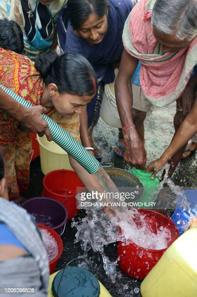 Indian people collect drinking water from a supply pipeline in Kolkata 22 March 2007 the World Water Day Millions of people in India do not access to...