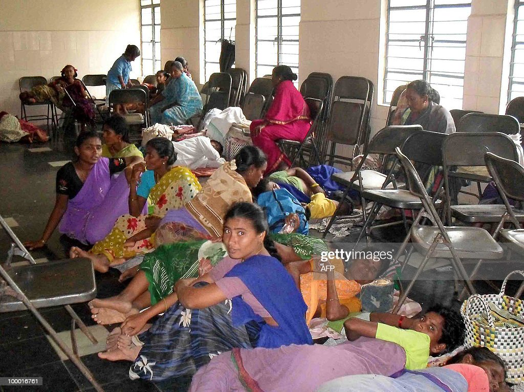Indian people evacuated from a cyclone effeted area take shelter in Vijayawada on May 20, 2010. A severe cyclone packing winds of 110 kilometres (70 miles) an hour hit India's southeast coast, forcing tens of thousands of people to evacuate their homes. Cyclone Laila slammed into the state of Andhra Pradesh about 50 kilometres southwest of the city of Machilipatnam, the Indian Meteorological Department (IMD) said.