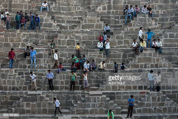 Indian people gather at the historic Chand Baori stepwell in Abhaneri village of western Rajasthan state on September 24 2015 For a few hours on one...