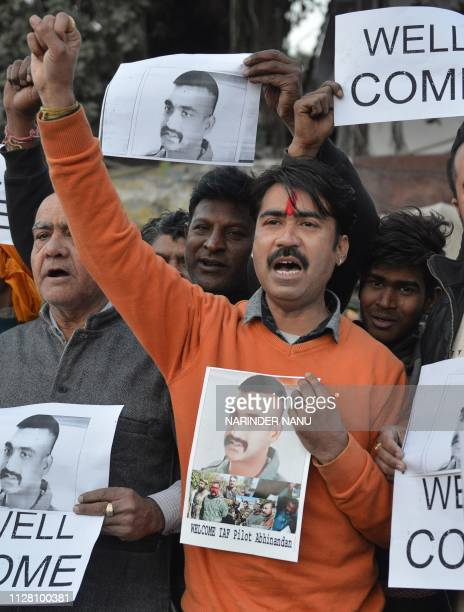 Indian people hold placards and photographs of Indian Air Force pilot Abhinandan Varthaman as they celebrate the announcement of his soon release in...