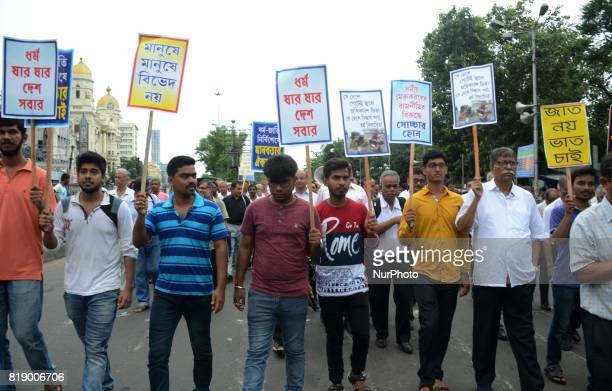 Indian people hold the placards as they take part in peace and unity rally in Kolkata India on Wednesday 19th July 2017