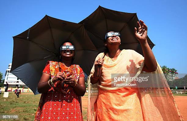 Indian people Vishnumitra Aria observe the rare Annular Solar Eclipse at the central stadium on January 15 2010 in Thiruvananthapuram Kerala South...