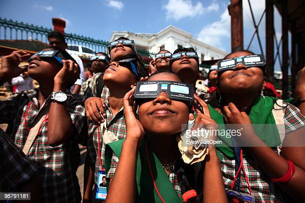 Indian people observe the rare Annular Solar Eclipse at the central stadium on January 15 2010 in Thiruvananthapuram Kerala South IndiaThis rare...