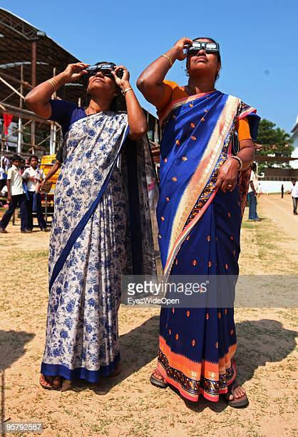 Indian people observe the rare Annular Solar Eclipse on January 15 2010 at the central stadium of Thiruvananthapuram in Kerala South IndiaThis rare...