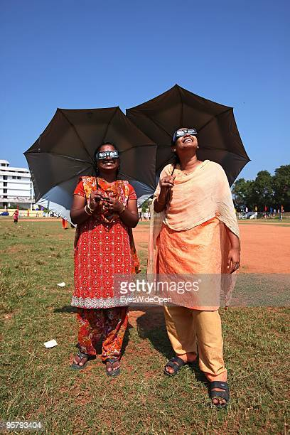 Indian people Vishnumitra Aria observe the rare Annular Solar Eclipse on January 15 2010 at the central stadium of Thiruvananthapuram in Kerala South...