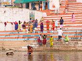 traditional indian hindu people bathing washing