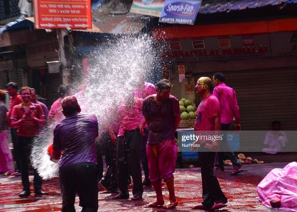 Indian People playing with coloured water during Holi festival in Kolkata, India on Monday, 13th March, 2017. Holi , festival of colours celebrated all over in India.