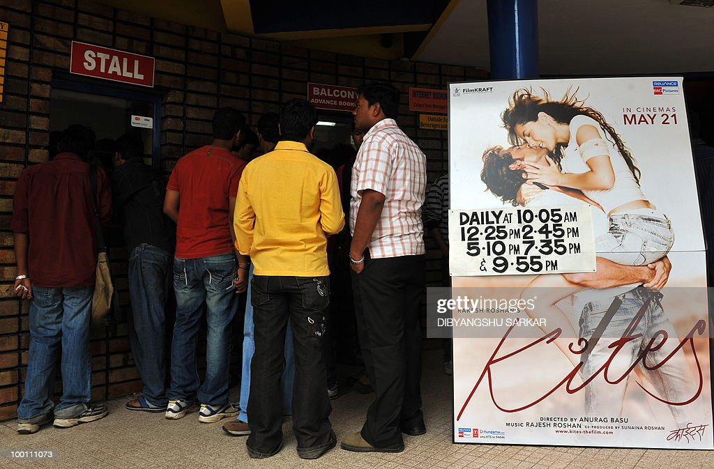Indian people queue to purchase tickets for the newly released Bollywood movie Kites in Bangalore on May 21, 2010. Kites has been banned for exhibition in the state of Karnataka by the Karnataka Film Chamber of Commerce (KFCC) for violating local industry norms. AFP PHOTO/Dibyangshu SARKAR