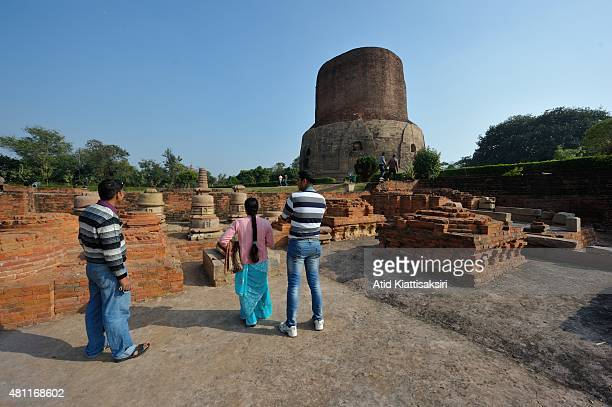 Indian people sightseeing at the ancient remains of the Dhamekh Stupa in Sarnath The Dhamek Stupa was built in 500 CE by king Ashoka along with...