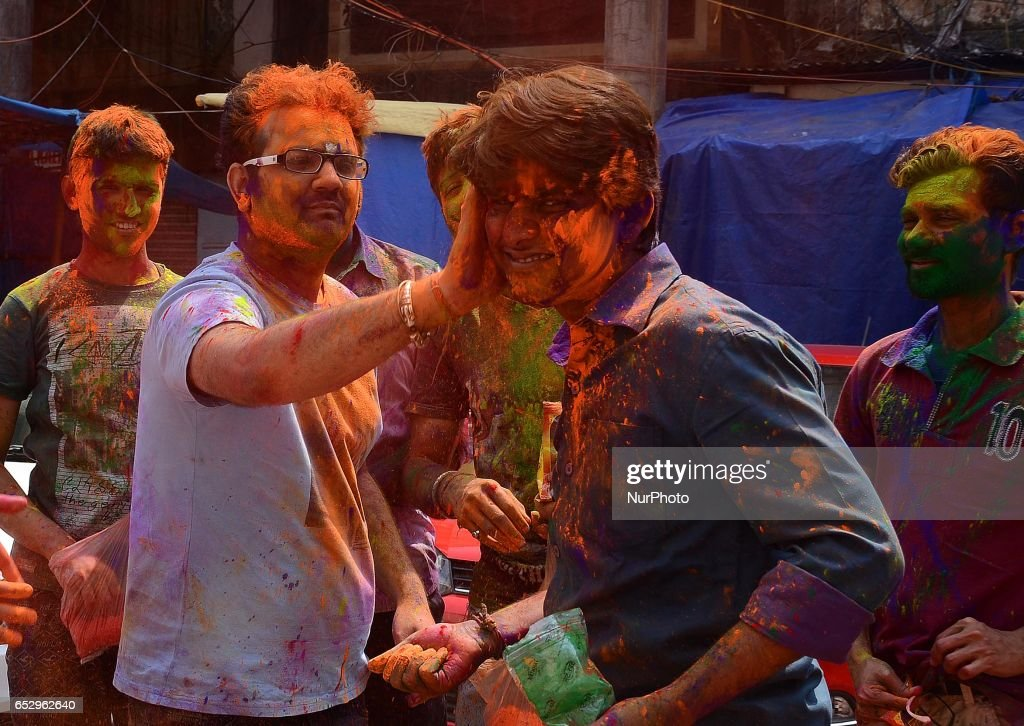 Indian People smear each other with colour powder during Holi festival in Kolkata, India on Monday, 13th March, 2017. Holi , festival of colours celebrated all over in India.
