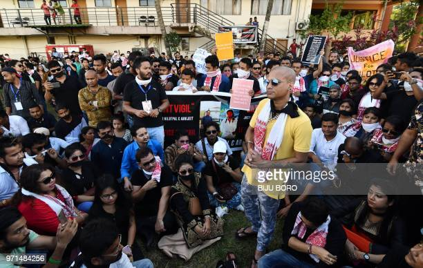 Indian people stage a silent protest demanding to arrest and punish the culprits involved in the killing of two youth in Karbi Anglong district of...