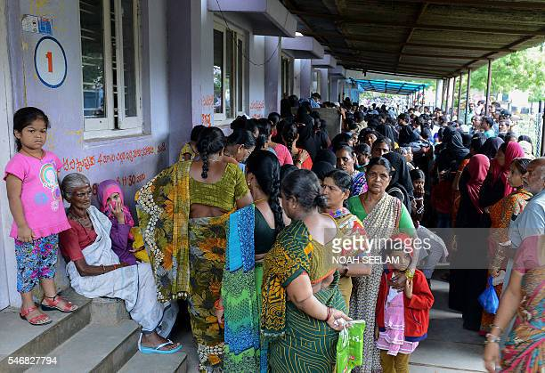 Indian people wait in line to register to consult with a doctor at the out patient wing of the Fever Hospital in Hyderabad on July 13 2016 The...