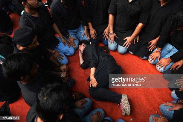 Indian performers act out an acid attack as they mark the beginning of a hunger strike by acid attack survivors in New Delhi on December 12 2014...
