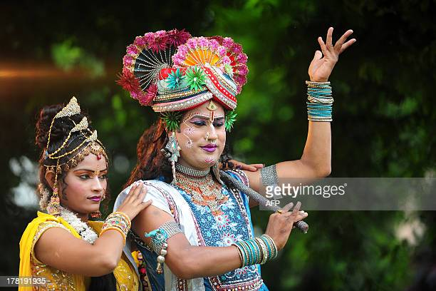 Indian performers one dressed as Hindu god Lord Krishna participate in a religious procession on the eve of Krishna Janmashtami in Allahabad on...