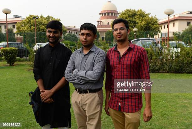 Indian petitioners Anwesh Pokkuluri Romel Barel and Krishna Reddy pose for photographers in front of the Indian Supreme Court in New Delhi on July 10...