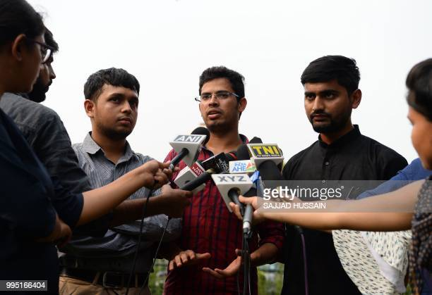 Indian petitioners Romel Barel Krishna Reddy and Anwesh Pokkuluri speak with the media near the Indian Supreme Court in New Delhi on July 10 2018...