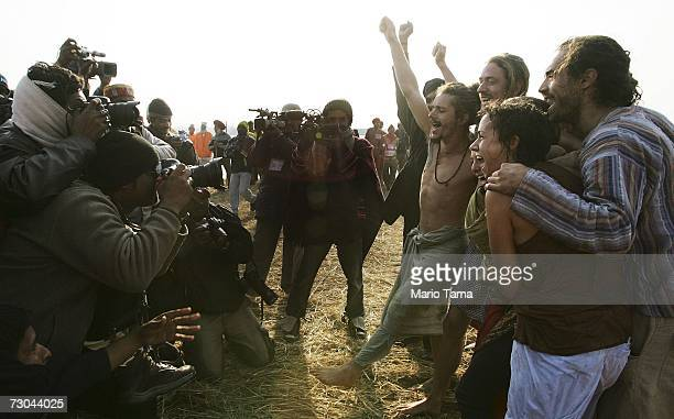 Indian photographers takes pictures of Western tourists including Mark Wiseberg from Manchester England after they took a holy dip at the ritual...