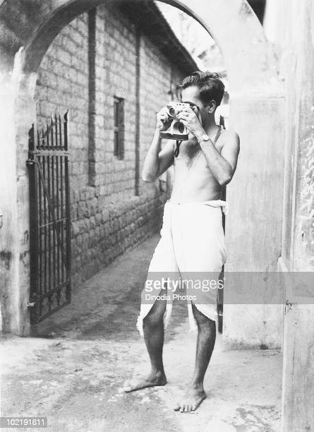 Indian photojournalist TSSatyan using a Leica camera at a temple in the holy town of Udupi South India Karnataka India 1948