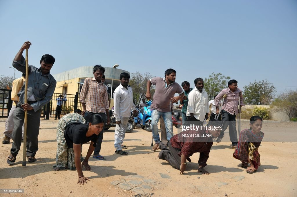 Indian physically handicapped employees of the Hyderabad Gems Special Economic Zone (SEZ) arrive for a protest outside Rajiv Gems Park at Ravirala village on the outskirts of Hyderabad on February 21, 2018. Some 300 physically handicapped employees who are working in the Hyderabad Gem SEZ fear for their jobs due to the involvement with the Gitanjali group, which has been linked to the PNB bank scam. India's federal police have arrested six people, including employees of a billionaire jeweller, as an inquiry into one of the country's biggest bank scams widens, investigators said February 21. Nirav Modi and his uncle and business partner Mehul Choksi, and by extension his promoted Gitanjali group, have been accused by investigators of defrauding the Punjab National Bank of 2.8 billion rupees ($43.8 million), part of the total losses. /
