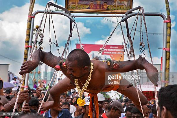 Indian pilgrim hooked to his back. Thaipusam is a hindu festival celebrated mainly by the Tamil community. Outside of India, it is celebrated mainly...