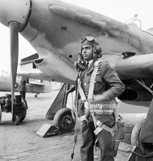 Indian Pilots Train For The Indian Air Force A student Indian IAF pilot with flying kit photographed beside his Hurricane before a training flight at...