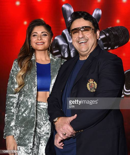 Indian playback singer Kanika Kapoor and Bollywood singer musician and music composer Adnan Sami pose for photographs for the media at the TV singing...