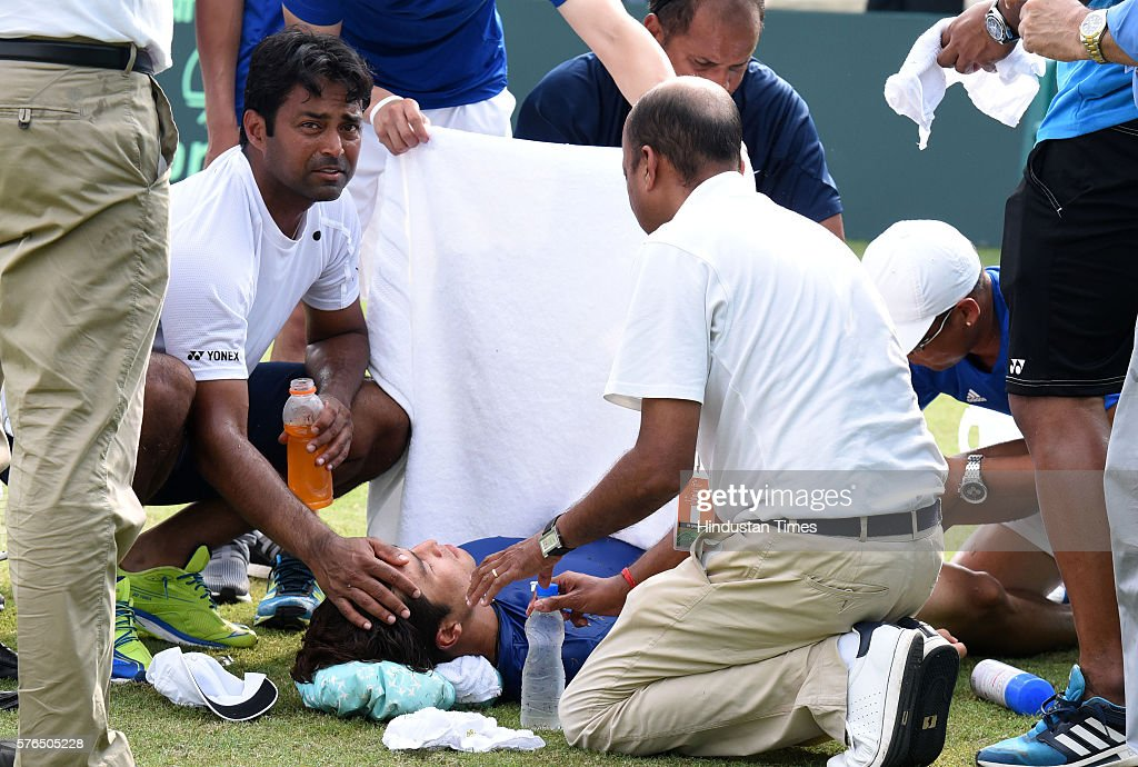 Indian player Leander Paes helping Korean player Yong Kyu Lim collapsed after cramps during the second match Davis Cup tie between India and Korea at.