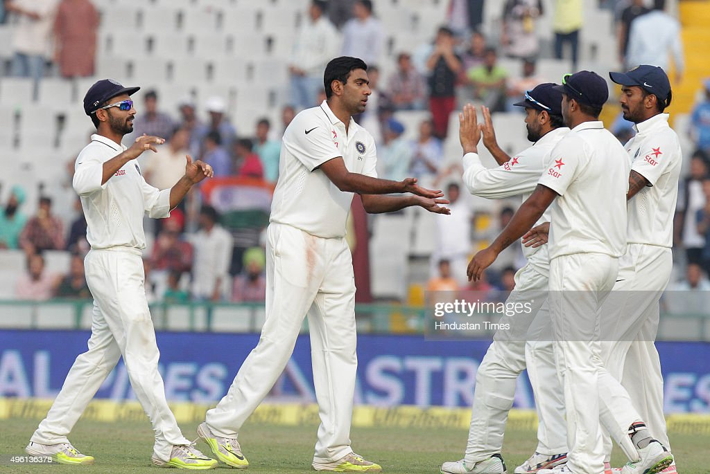 Indian player R Ashwin celebrating with team players after dismissal of South African player Dale Steyn during the third day of first Test match been.