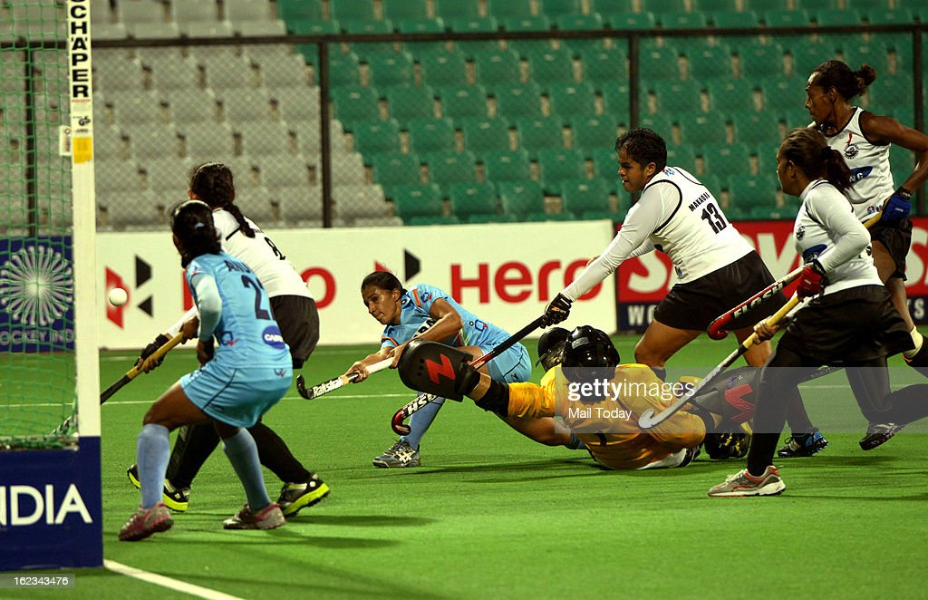 Indian player Rani attacks as Fiji's goalkeeper Susana fails to save 04th goal during their FIH Hockey World League Round 2 (women) match at National stadium on Thursday.