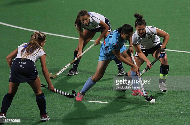 Indian player Rani Rampal is surrounded by Italian players during the FIH London Olympics hockey qualifying match between India and Italy at National...