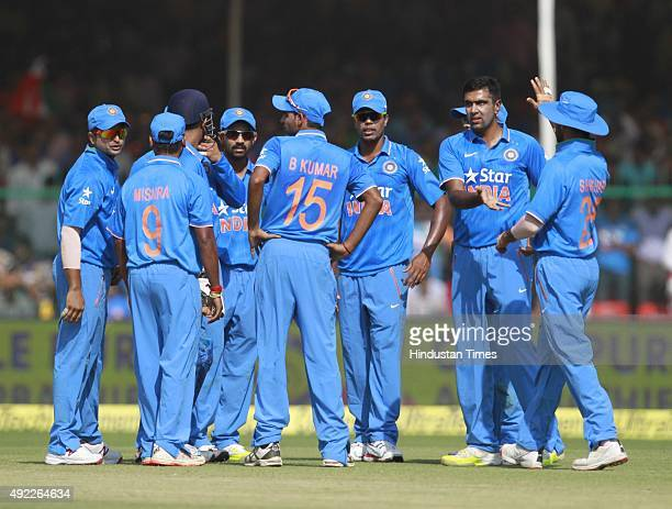 Indian player Ravichandran Ashwin with team members celebrate after the dismissal south Africa`s Quinton de Kock during the first One Day...