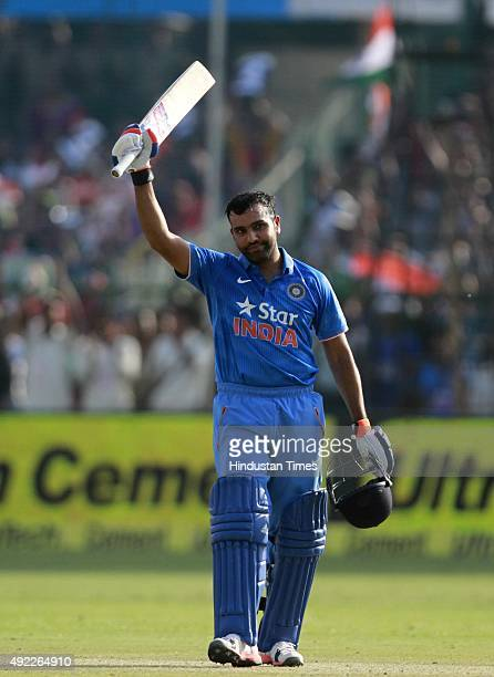 Indian player Rohit Sharma celebrates after his century against South Africa during the first One Day International match between India vs South...