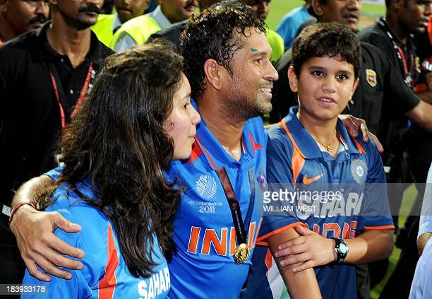Indian player Sachin Tendulkar walks with his children Arjun and daughter Sara after India defeated Sri Lanka in the ICC Cricket World Cup 2011 final...