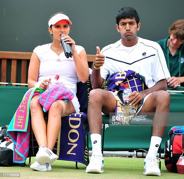 Indian player Sania Mirza and Indian player Rohan Bopanna sit on the bench as they play against Bristish player Jamie Murray and Australian player...