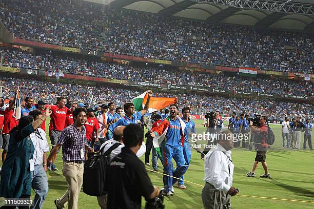 Indian Player Yuvraj Singh celebrates with team members after winning the ICC Cricket World Cup 2011 Final match at The Wankhede Stadium in Mumbai on...
