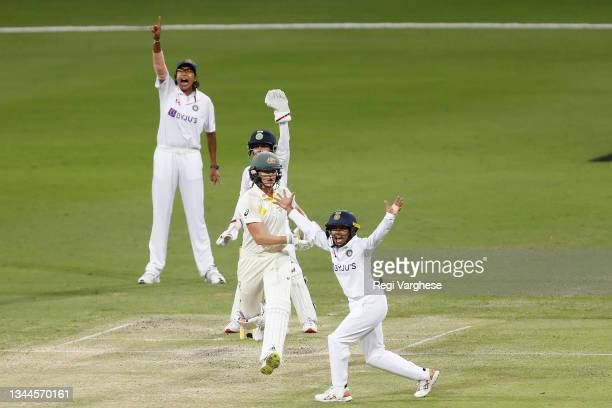 Indian players appeal for the wicket of Ellyse Perry of Australia during day four of the Women's International Test Match between Australia and India...
