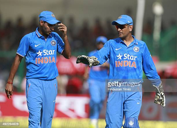 Indian players captain MS Dhoni and Bhuvneshwar Kumar during the first One Day International match between India vs South Africa at Green Park...