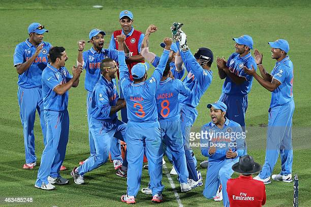 Indian players celebrate a wicket during the 2015 ICC Cricket World Cup match between India and Pakistan at Adelaide Oval on February 15 2015 in...